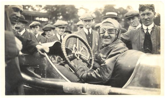 A smiling Percy Lambert at the wheel of his 25h.p. Talbot after completing the record